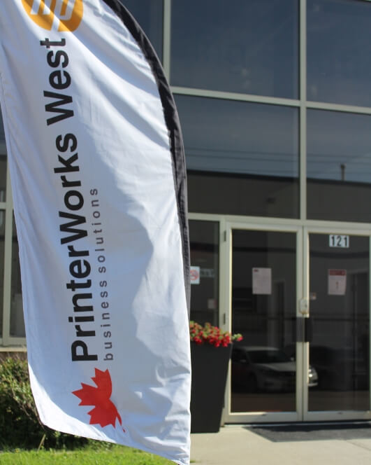 Banner in-front of PrinterWorks West Calgary Head Office